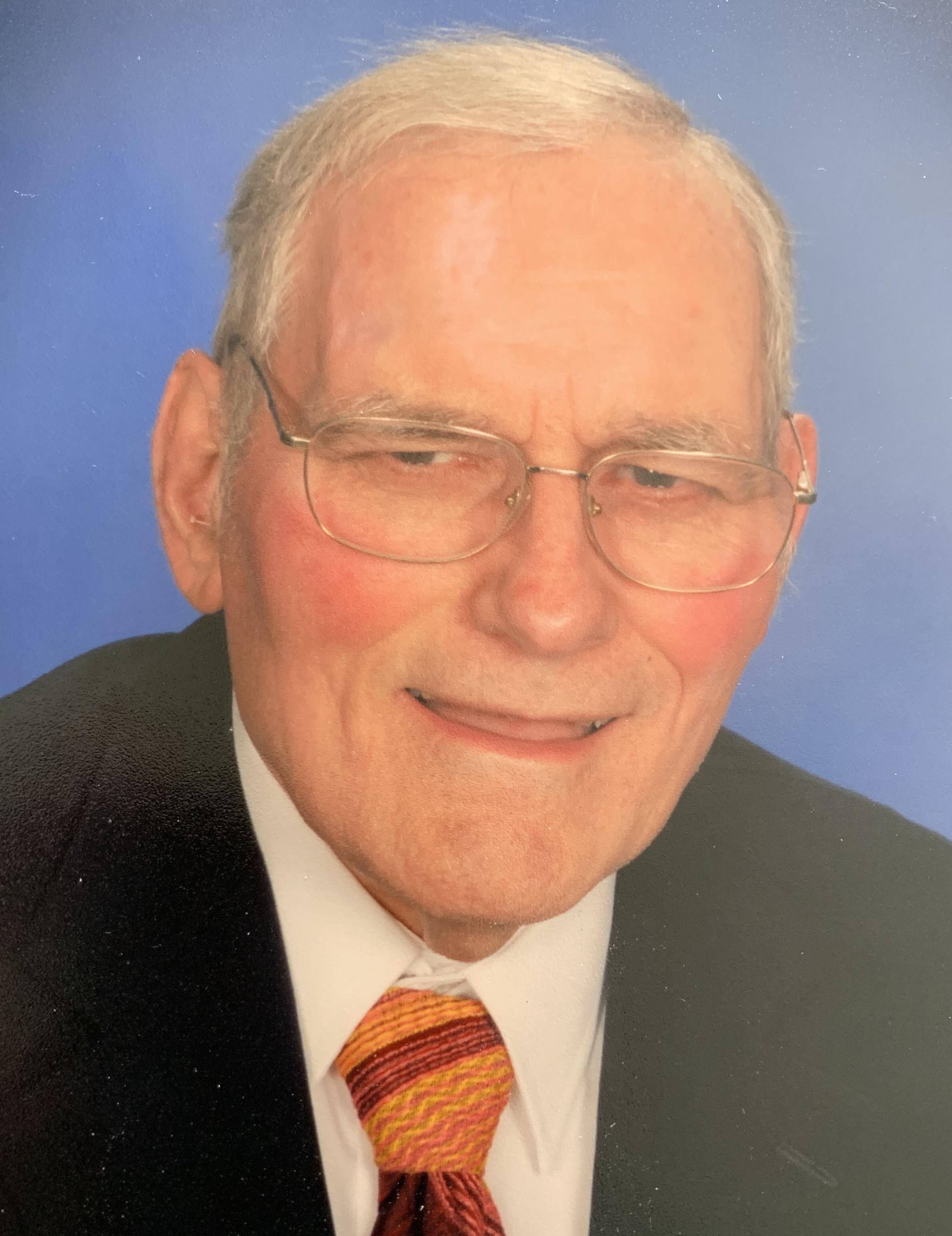 Dr John Kizior
