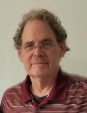 Mark A. Hughes