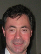 William E Brennan